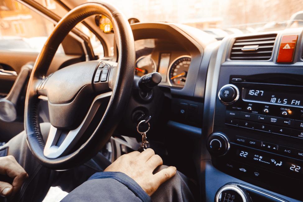 Man-inside-car-steering-wheel