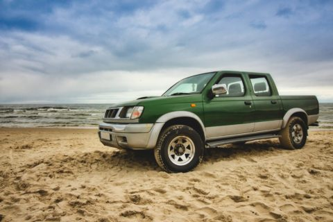 Used-truck-green-on-the-beach
