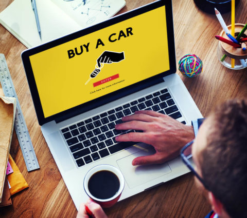 Man-buying Used-Car-online-via-laptop