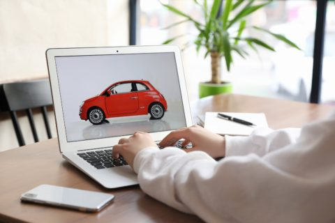 Woman-Using-Laptop-To-Buy-Car