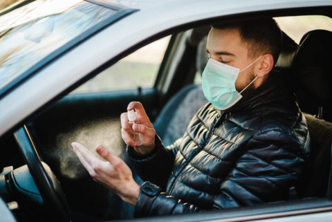 man-in-used-car-Spraying-Anti-bacterial-Sanitizer-coronavirus-precautions
