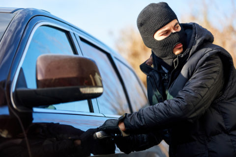 Car-Thief-Attempting-to-Break-Into-Car-Door