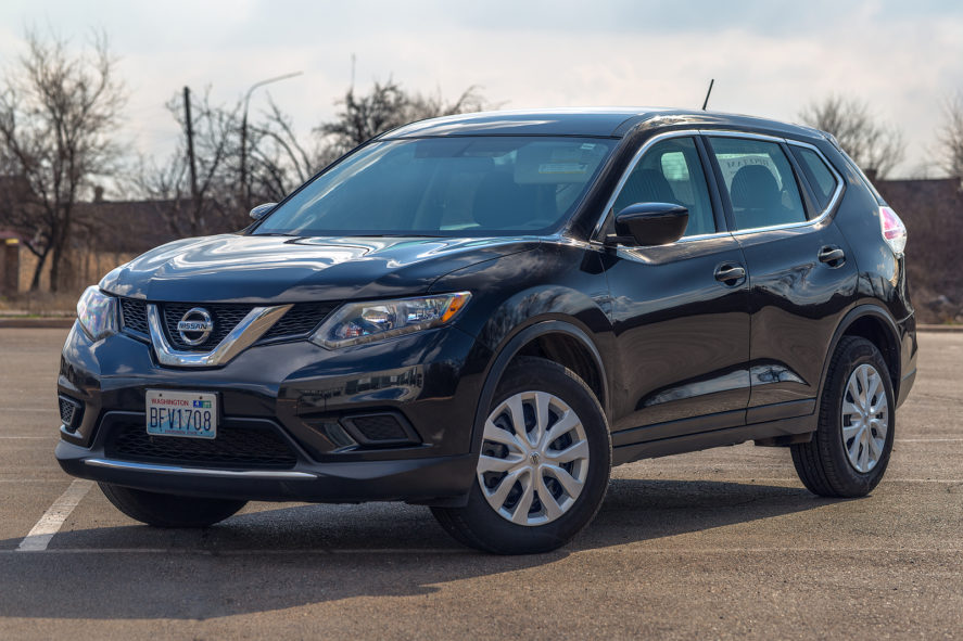 Photo-of-Black-Nissan-Rogue-Car-Parked-Outside